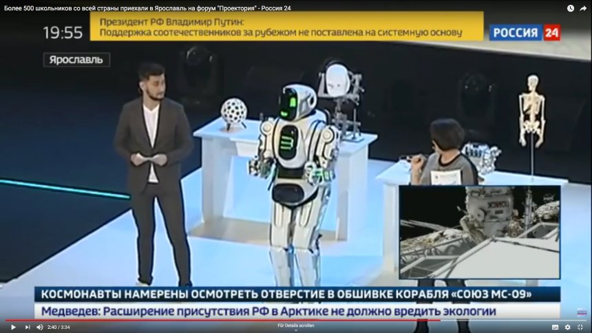 Dancing Russian robot unmasked as a 'person in a suit'